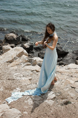 Girl playing violin at the beach in blue 3