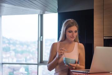 woman eating breakfast enjoying relaxing lifestyle