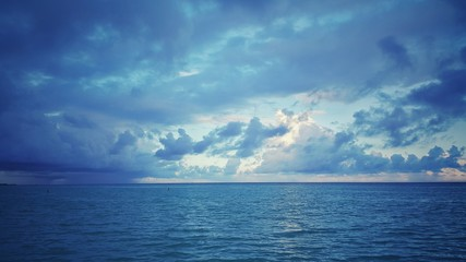 Sea sunrise over the atlantic ocean. Rainy clouds.