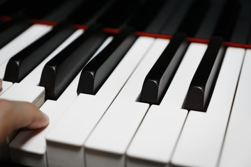 Piano keys on black classical grand piano - closeup for music production and recording