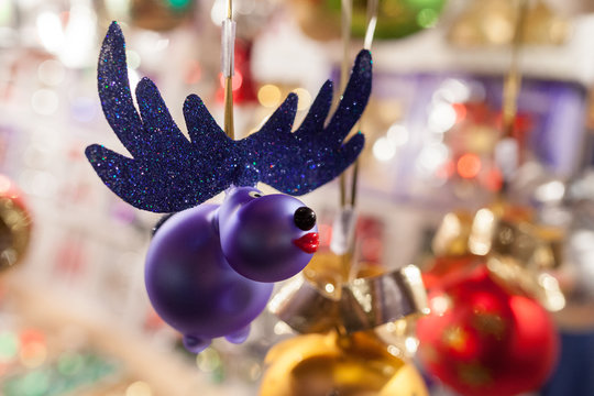 Pink moose as a christmas decoration on a market with bokeh