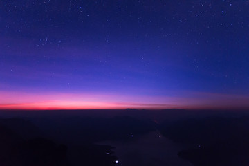 The milky way rises over the Mae Ping national park at sunrise, Pha dang luang view point  Li, Lamphun in Thailand