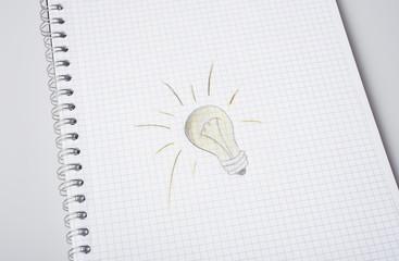 hand drawn light bulb on paper