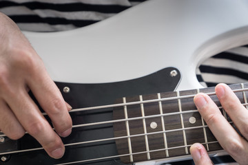 bass guitar finger style closeup - musical instruments - concept musical composition and creativity