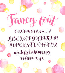 Fancy calligraphy font with watercolor spots isolated on background. Uppercase, lowercase letters, numbers and symbols. Hand drawn modern script. Beautiful modern alphabet.