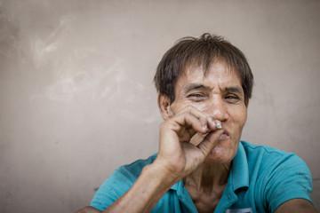 Old man is smoking. Selective focus. Soft focus.