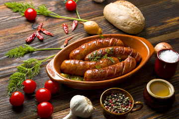 Fried sausage on a wooden background