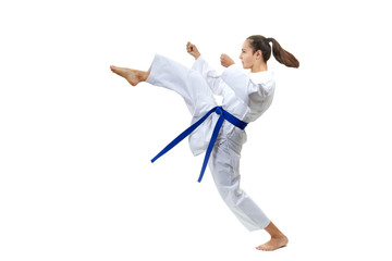 Adult girl with a blue belt beats kick leg