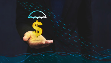 Financial Care by Insurance in Flood Crisis Concept, Golden Dollars Sign float over Businessman hand with Raining, Dark light, Front view