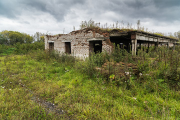 Dilapidated cowshed in an abandoned farm