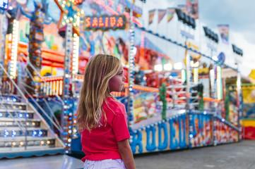 Little girl  in the summer amusement park