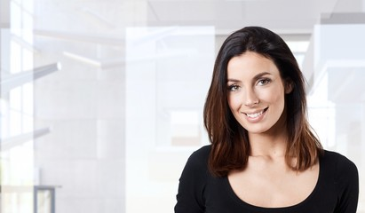 Happy young woman in office smiling portrait