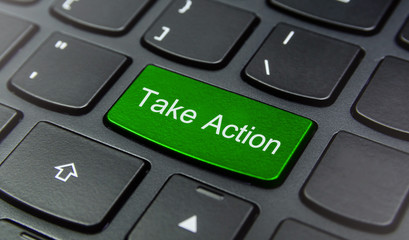 Close-up the Take Action button on the keyboard and have Green color button isolate black keyboard