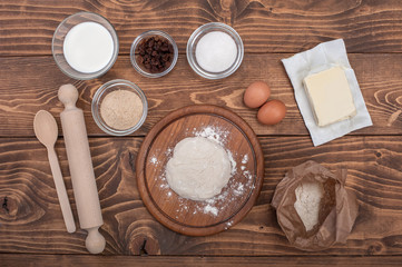 Food ingredients for dough a wooden kitchen board. Cake recipies