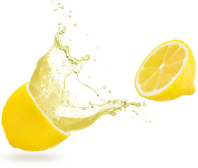 Wall Mural - juice spilling out of a lemon isolated on white