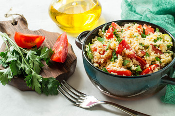 Bowl with couscous, vegetables and herbs