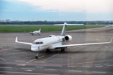 Modern plane in big city airport