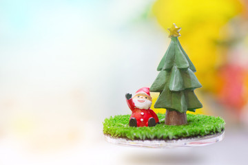 Santa Claus and Christmas gift Signs of Christmas toy souvenir with colour of bokeh background.