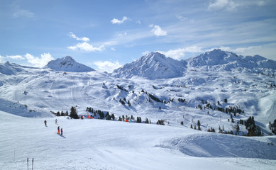 Wide snowy slopes in high mountains in La Plagne ski resort, Alps, France