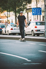 Professional skater riding skate on streets through cars and traffic