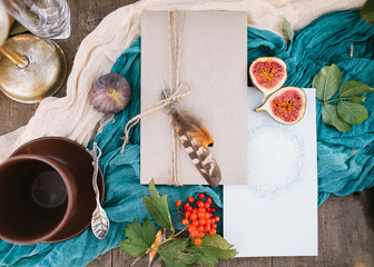 engagement, fall, eco style concept. flatlay of wonderful set of wedding polygraphy for invitations of guests, cards are pastel coloured and decorated with autumn sybols, figs and rowanberries