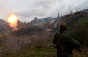 "Members of the association historical recreation Frente del Nalon participate in the recreation of the battle ""La Loma del Pando\"