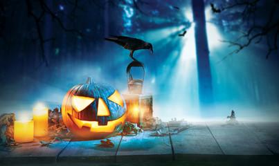 Spooky halloween pumpkin on wooden planks