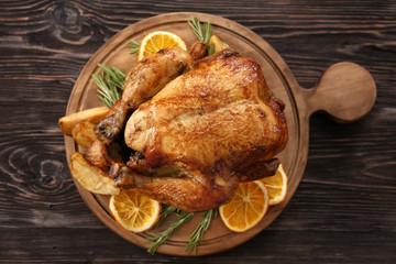 Roasted turkey on wooden board