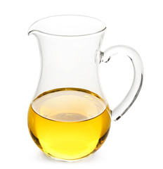 Glass pitcher with cooking oil on white background