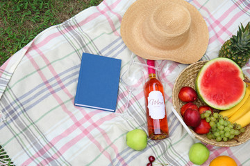 Composition with fruits and wine on picnic blanket