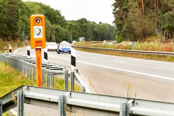 SOS phone. Emergency telephone at the roadside. Morning on the German highway.