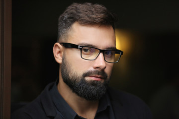 bearded boy in glasses