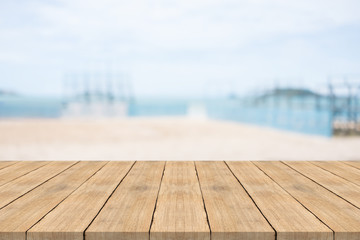 Empty wooden table in front with blurred background at the beach,space for montage you products