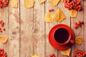 Red cup of coffee on grey wooden background, top view, copy space