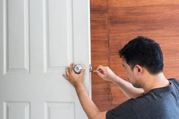 locksmith install and repair knob on white wood door