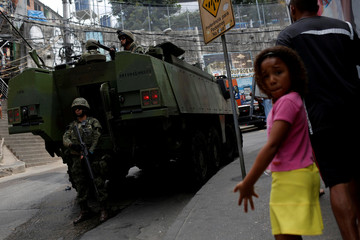 A military vehicle is pictured during an operation after violent clashes between drug gangs in Rocinha slum in Rio de Janeiro