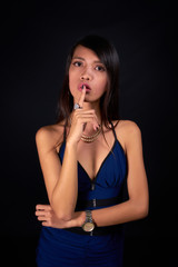 Beautiful woman posing - finger on lips