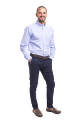 Young business man standing with hands in pockets on a white background