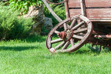 An old cart for transportation on green grass close-up