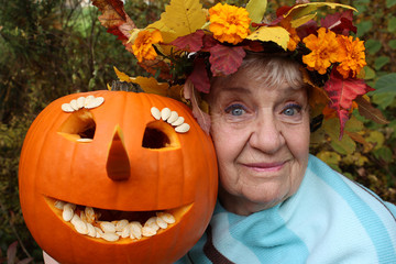 old happy woman with a pumpkin