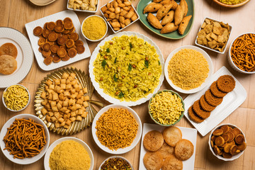 stock photo of  Diwali food or Diwali snacks or Diwali sweets like anarsa, bakarvadi, chakli, sev, bhujiya, shankar pale and chivda or chiwada, karanji, favourite indian diwali recipe,