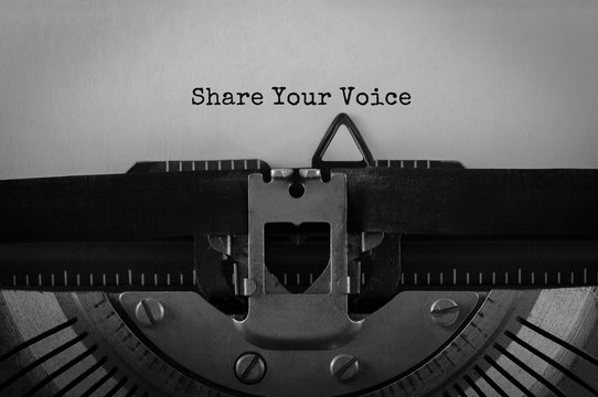 Text Share Your Voice typed on retro typewriter