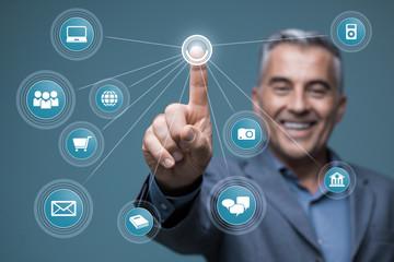 Smiling businessman using a virtual interface