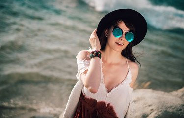Styled hippie girl at the beach, boho fashion