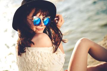 Styled hippie girl at the beach, boho fashion