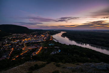 View on small city along river Danube after sunset, Hainburg der donau, Austria