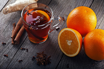 hot tea with spices and oranges