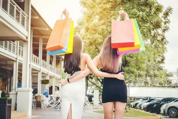 Happy women friendship Enjoying Spending shopping bags in Fashion shopping street