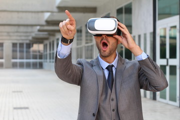 Businessman pointing while using virtual reality glasses