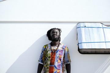 Black man posing at street